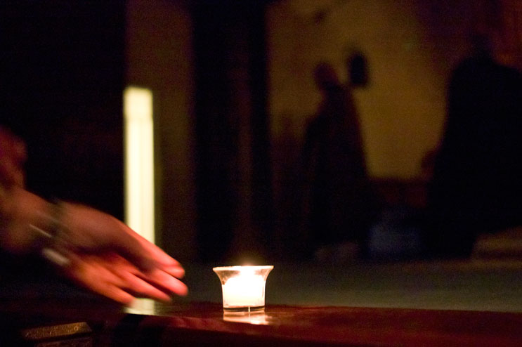 A worshipper puts down a candle in front of the altair during a memorial service for the victims of the March 2011 earthquake and tsunami in Japan at Zenshuji Soto Mission in Little Tokyo in Los Angeles, Calif., Sunday, March 20, 2011.