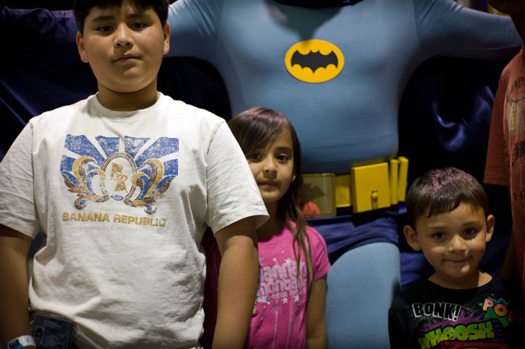 "From left, Adam, 9, Allison, 6, and Anakin Bautista, all of Lynwood, Calif., pose for a portrait with Batman (a.k.a. John Whitt, of Minneapolis, Minn). ""I like to meet the movie stars and the action figures,"" said Angel Bautista (not pictured), the children's father."