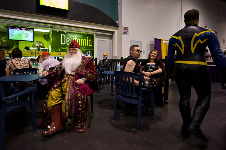 "Shaunn Lawrence, left, of Los Angeles, takes a break in his $1,200-Dumbledore costume. Lawrence, a professional costumer for 33 years, made the costume himself after taking measurements and sketches off the original during an exhibition at the Academy Museum of Motion Pictures in Beverly Hills. ""I had to use cotton gloves when I did it,"" he said."