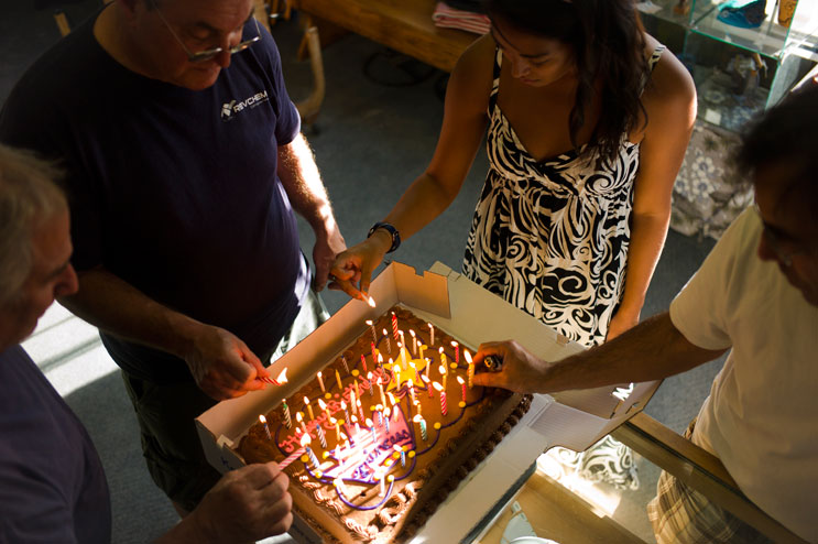 Terry Senate and his friends light the candles on his birthday cake at his surf shop in San Clemente, Calif., May 2, 2011.