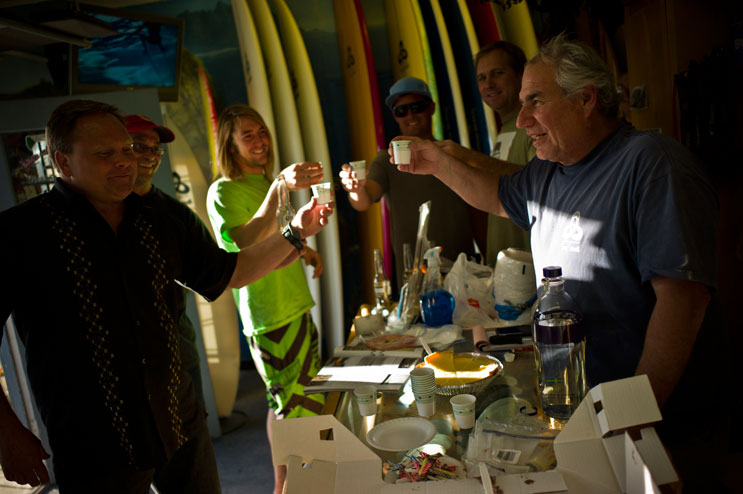 Terry Senate clinks glasses with his friends on his birthday at his surf shop in San Clemente, Calif., May 2, 2011.