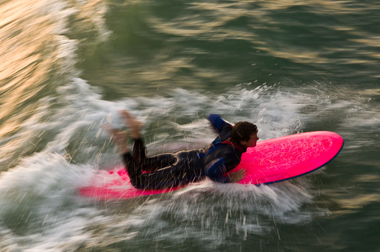 Matteson Morey, of San Clemente, Calif., surfs near the San Clemente Pier, May 11, 2011.