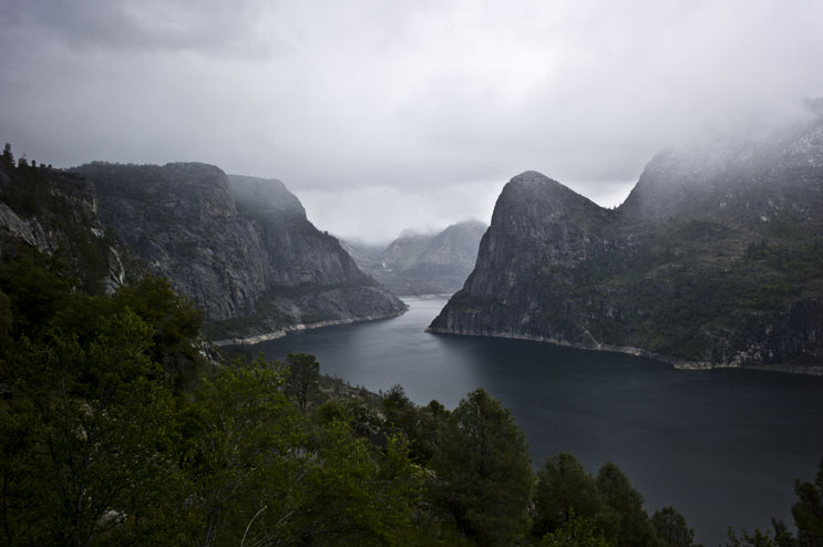 Clouds engulf the peaks over Hetch Hetchy Reservoir at Yosemite National Park, May 29, 2011.