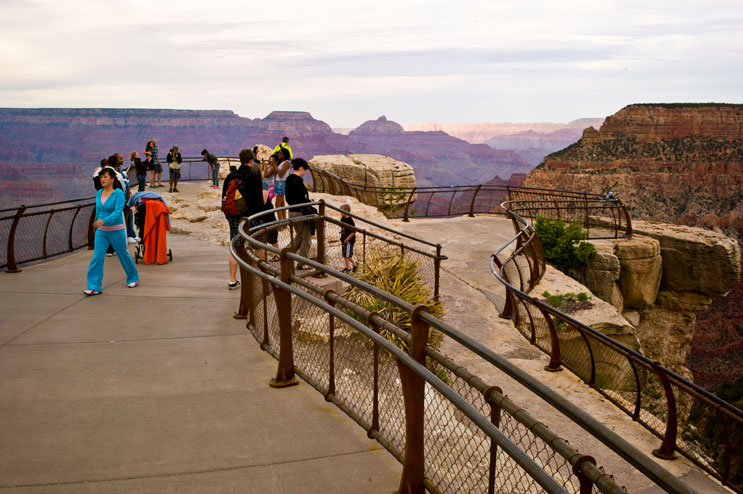Visitors overlook the Grand Canyon from a boardwalk near the visitor center on the South Rim, Grand Canyon National Park, Arizona, Wednesday, June 1, 2011.
