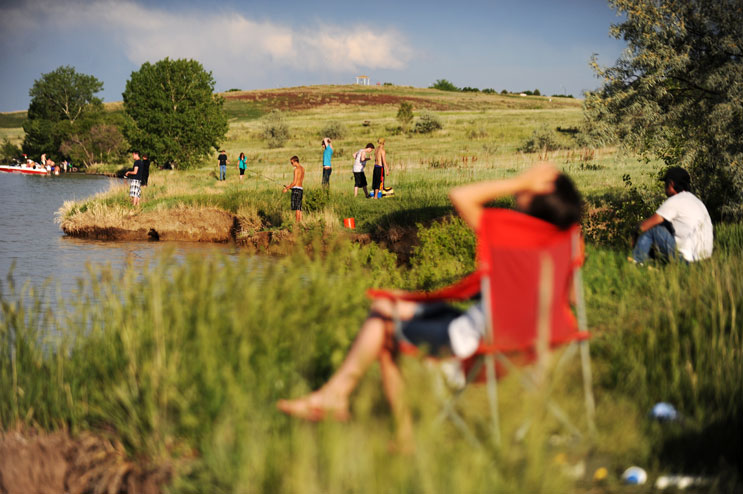 People unwind at Standley Lake in Arvada, Colo., Sunday, June 12, 2011.