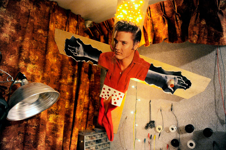 An Elvis collage hangs in the band room in the garage of Gregory Hill's Denver home, Saturday, June 25, 2011.