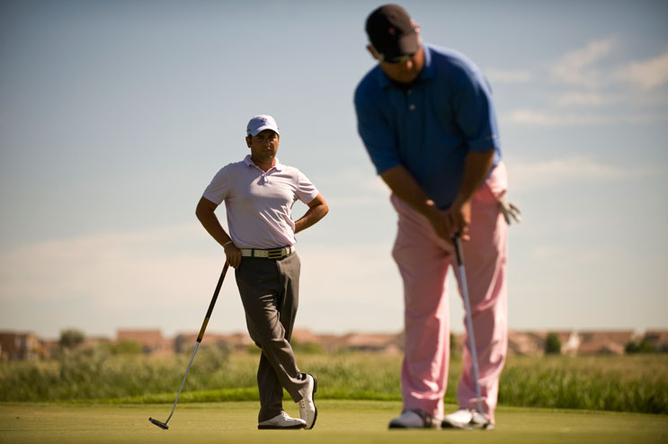 """Zach Byrd, the pro member of the Humana team, watches team mate John """"2E"""" Cullen put at the ninth hole of Green Valley Ranch Golf Club during the pro-am shotgun, Wednesday, July 20, 2011."""