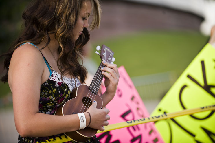 Miranda Barness plays Ukulele while waiting in line for the American Idol Season 11 auditions at Invesco Field at Mile High in Denver, Friday, July 29, 2011.