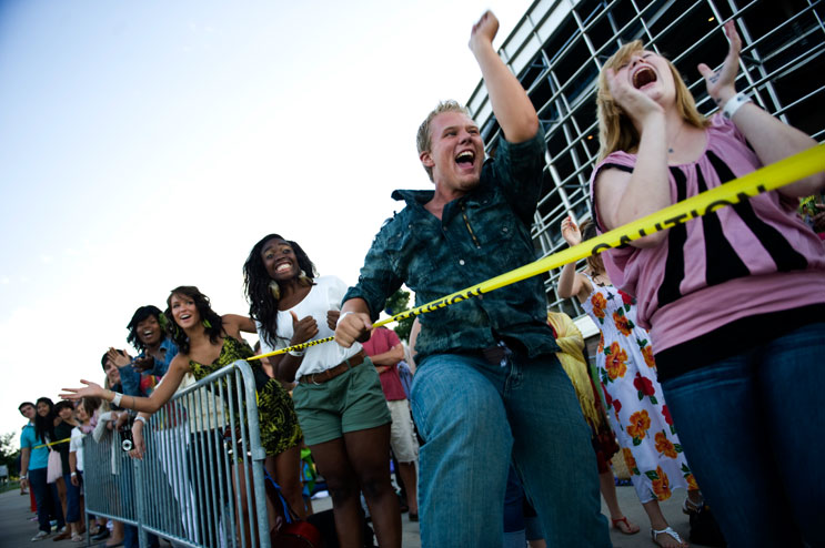 "Sebastian Smith, second from right, tries to attract the attention of a camera team before the American Idol Season 11 auditions at Invesco Field at Mile High in Denver, Friday, July 29, 2011. ""I'm gonna be the next American Idol,"" he screamed. ""Not these guys! Me!"""