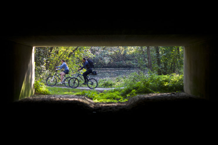 Bicyclists ride past a pedestrian underpass on the Altmühl bike trail near Essing, Monday, October 3, 2011.