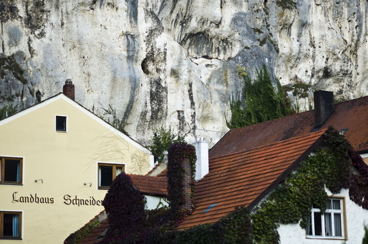 The historic houses near the market square in Essing are dwarfed by the limestone cliffs that tower over them, Monday, October 3, 2011.