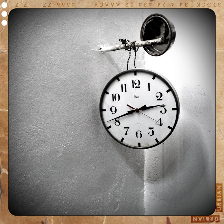 An old clock hangs on a wall inside the brewery Ottenbräu in Abensberg, Germany, Saturday, October 29, 2011.