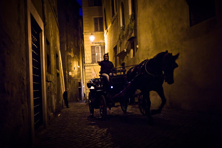 A horse carriage drives through the narrow alleys near the Piazza Margana in Rome, Italy, Monday, October 31, 2011.