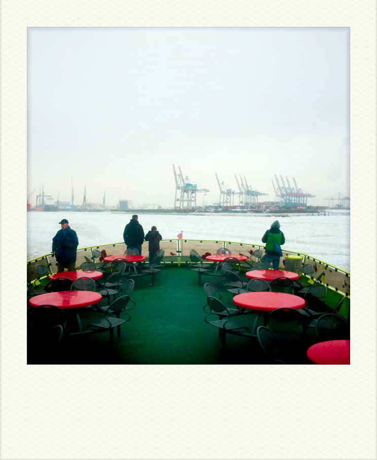 Passengers on a ferry take in the view of the Elbe harbor in Hamburg, Monday, February 13, 2012.