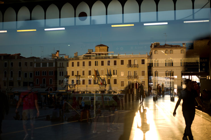 The setting sun shines through the main hall of Santa Lucia train station in Venice, Italy, Tuesday, June 26, 2012. The construction of the railway bridge that connects the laguna with the mainland has severly disturbed the natural tidal flow around Venice, leading to increased floods.