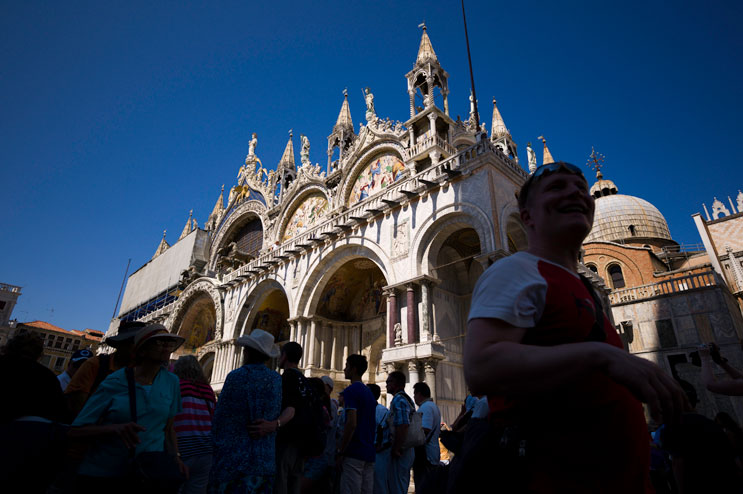 Hordes of tourists crowd the area in front of the Basilica di San Marco at St. Mark's Square in Venice, Italy, Wednesday, June 27, 2012. The Piazza St. Marco and its surrounding buildings are the most famous architectural landmark in Venice.