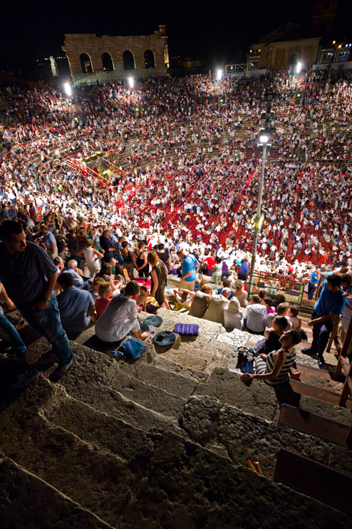 Spectators leave the Arena di Verona during intermission of the premiere show of the opera Carmen during the 90th Arena di Verona Opera Festival, Saturday, June 30, 2012. If you look closely, you can find Rita and Beth in there, too...