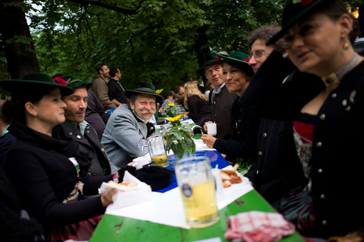 Visitors of the 2012 Kocherlball sit in the beer garden at the Chinese Tower (Chinesischer Turm) in Munich's city park Englischer Garten, Sunday, July 15, 2012.