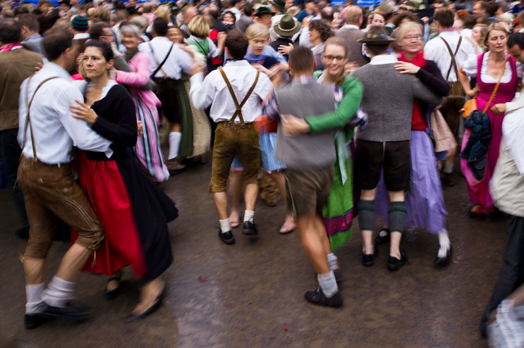 People dance traditional Bavarian dances at the Kocherlball at the historic Chinese Tower (Chinesischer Turm) beer garden in Munich's city park Englischer Garten, Sunday, July 15, 2012.