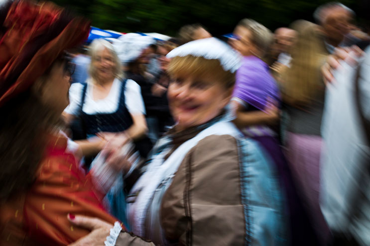 People dance traditional Bavarian dances during the Kocherlball at the historic Chinese Tower (Chinesischer Turm) beer garden in Munich's city park Englischer Garten, Sunday, July 15, 2012.