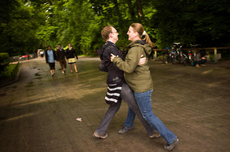 A couple dances away from the bath rooms during the Kocherlball, a traditional Bavarian dance at the historic Chinese Tower (Chinesischer Turm) beer garden in Munich's city park Englischer Garten, Sunday, July 15, 2012.