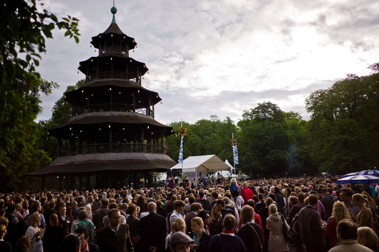 Thousands of people participate in traditional Bavarian dancing at the 2012 Kocherlball under the historic Chinese Tower (Chinesischer Turm) in Munich's city park Englischer Garten, Sunday, July 15, 2012.