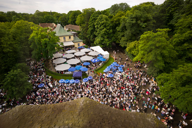 Thousands of people fill the beer garden at the historic Chinese Tower (Chinesischer Turm) beer garden in Munich's city park Englischer Garten during the Kocherlball, a traditional Bavarian dance, Sunday, July 15, 2012.
