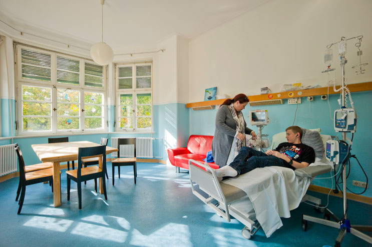 Jaqueline Thorwirth tends to her 15-year-old son Christoph while he is getting a round of chemo at the out-patient station of the children cancer ward at the hospital München Schwabing in Munich, Thursday, October 11, 2012. Christoph was diagnosed with Leukemia in April of 2012.