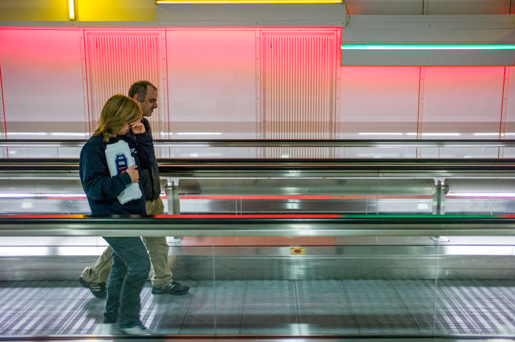 Sakis and Albena head to a public bathroom to take a shower. With 38 million passengers passing through annually, the airport offers little privacy to the family. Thursday, November 22, 2012.
