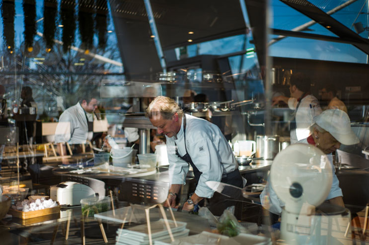 "Star chef Bobby Bräuer puts the finishing touches on a dish in the kitchen of the new Käfer restaurant ""Bavarie"" at the prestigious BMW Welt in Munich during the official opening of the restaurant on Wednesday, December 12, 2012."