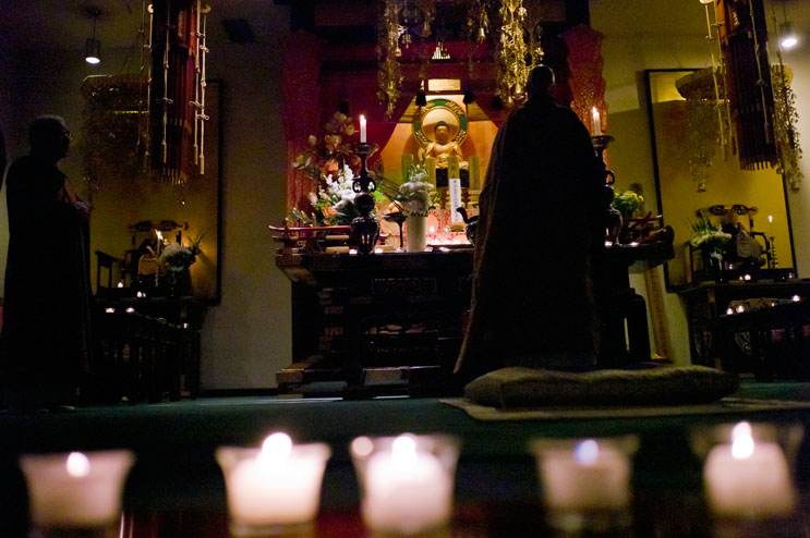 Bishop Daigaku Rummé performs a memorial service for the victims of the March 2011 earthquake and tsunami in Japan at Zenshuji Soto Mission in Little Tokyo in Los Angeles, Calif., Sunday, March 20, 2011.
