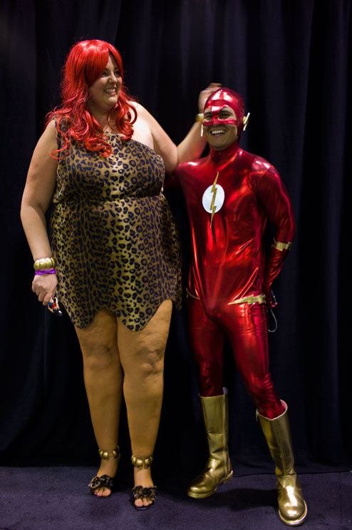 Autumn Will, left, as 'Giganta,' and her boyfriend Cesar Vargas, as 'The Flash,' pose for a portrait at the Wizard World Comic Con at the Anaheim Convention Center.