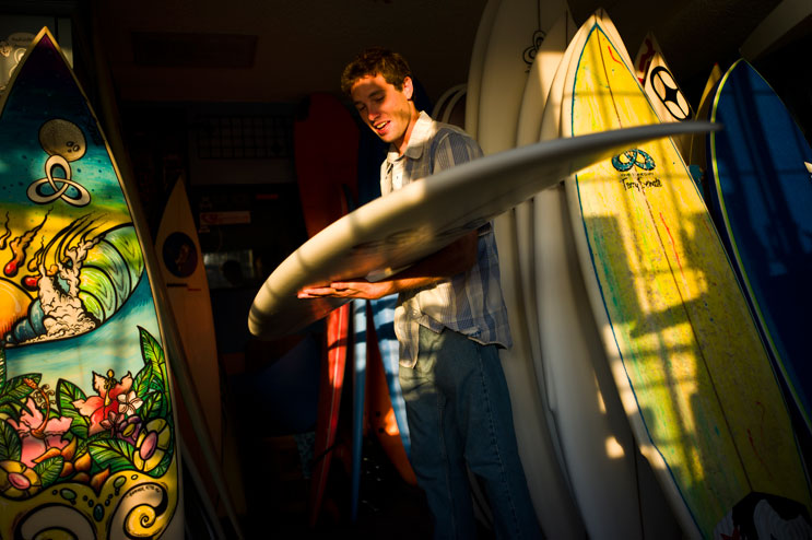 Tommy Witt, of San Clemente, Calif., picks up his new board at Terry Senate's surf shop, May 2, 2011.