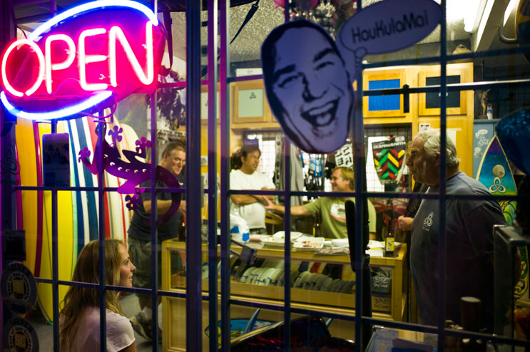 Terry Senate and his friends celebrate his birthday at his surf shop in San Clemente, Calif., May 2, 2011.