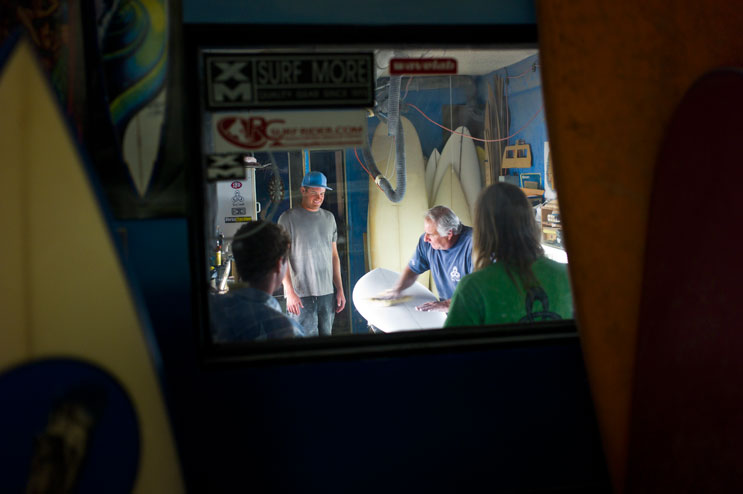 Terry Senate touches up a surfboard that one of his friends shaped and brought to his shop to show him, May 2, 2011.