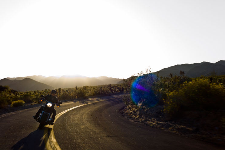 Maximilian Berr, of Dachau, Germany, rides his Harley Davidson down the Pinto Basin Road toward the Cholla Cactus Garden at Joshua Tree National Park, Calif., May 6, 2011.
