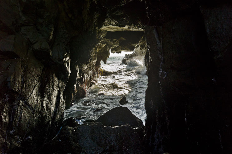 Waves crash through an opening in the rocks at Pfeiffer Beach in Big Sur, Calif., May 19, 2011.