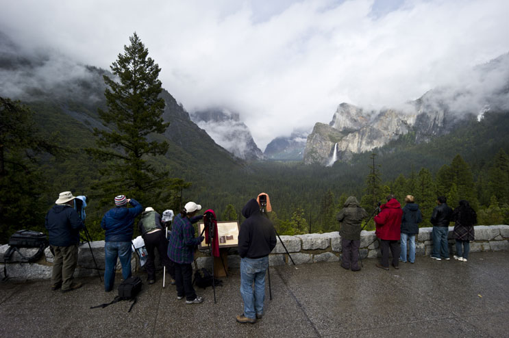 Participants of a photography workshop wait for the right light in the Yosemite Valley at Tunnel View, May 29, 2011.