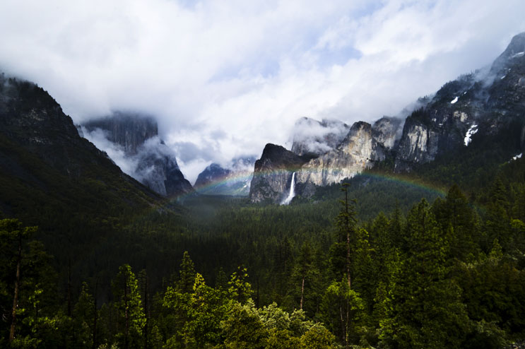 A rainbow hangs over Yosemite Valley as the sun breaks through heavy rain couds, Yosemite National Park, May 29, 2011.