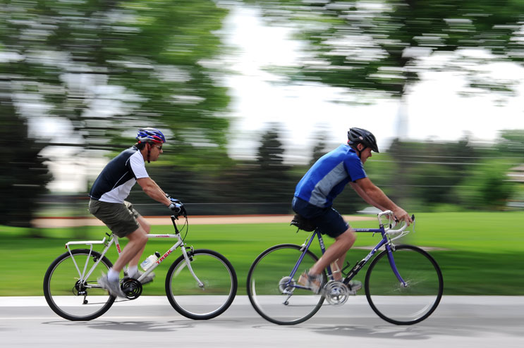 """Mike Picket, left, and his brother Jeff ride their bikes at Jackson Park in Lakewood, Colo., Friday morning, June 10, 2011. They are each going to ride a leg of the Ride the Rockies bike race in honor of their brother David, who was killed in a hit-and-run accident about a month ago while he was riding his bike. """"We'll just be thinking of Dave and of God and ask him to help us through this,"""" Mike Pickett said about the race."""