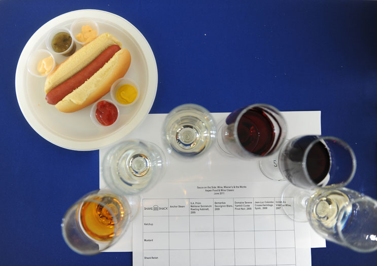 "Various wines and condiments along with a hotdog and a tasting matrix are laid out for participants of the ""Sauce on the Side: Wine, Wieners and the Works"" wine and hot dog tasting conducted by Danny Meyer at the Food & Wine Classic in Aspen Saturday, June 18, 2011."