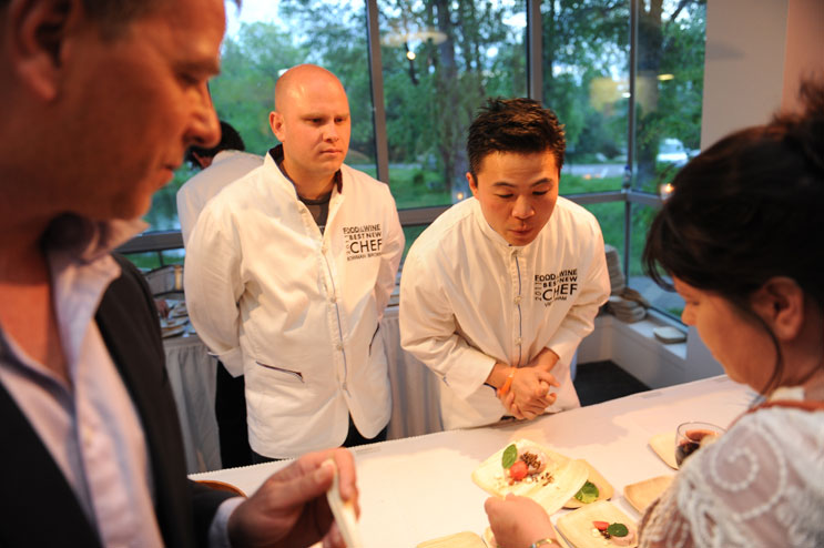 Bowman Brown, center left, and Viet Pham, the owners of the Forage restaurant in Salt Lake City, Utah, serve their Heritage Valley Organic Terrine Scented with Spruce at the 2011 Food & Wine Best New Chefs Dinner at the Aspen Meadows Resort Saturday, June 18, 2011.