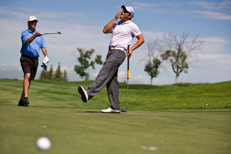 Zach Byrd, right, the pro member of the Humana team, and team mate Darin O'Shea react after Byrd missed a put at hole eleven during the pro-am shotgun at the Green Valley Ranch Golf Club, Wednesday, July 20, 2011.
