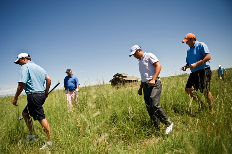 "From left, Tom Sanderson, college friend and caddy of professional golfer Zach Byrd, and Humana team members John ""2E"" Cullen, Zach Byrd, Matt Nelson and Dan Oftedahl search for a lost ball at hole fourteen during the pro-am shotgun at Green Valley Ranch Golf Club, Wednesday, July 20, 2011."