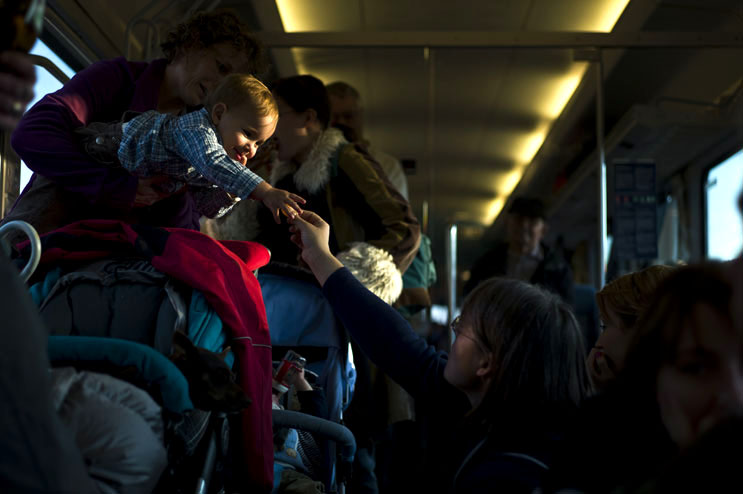 A woman hands a piece of tangerine to a baby on the regional train from Munich Central Station to Ingolstadt, Saturday, October 15, 2011.