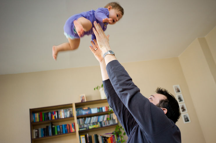 My brother Hansi tosses his youngest daughter, 9-month-old Clara, up in the air in the living room of their Bayreuth home, Saturday, March 3, 2012.