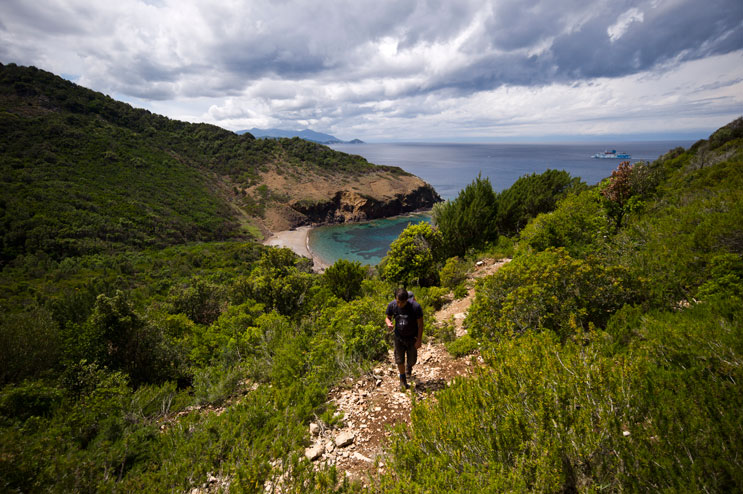 Florian Peljak hikes up the Percorso Pietre Rosse trail from Cala Del' Inferno beach in Rio nell'Elba, Monday, May 21, 2012.