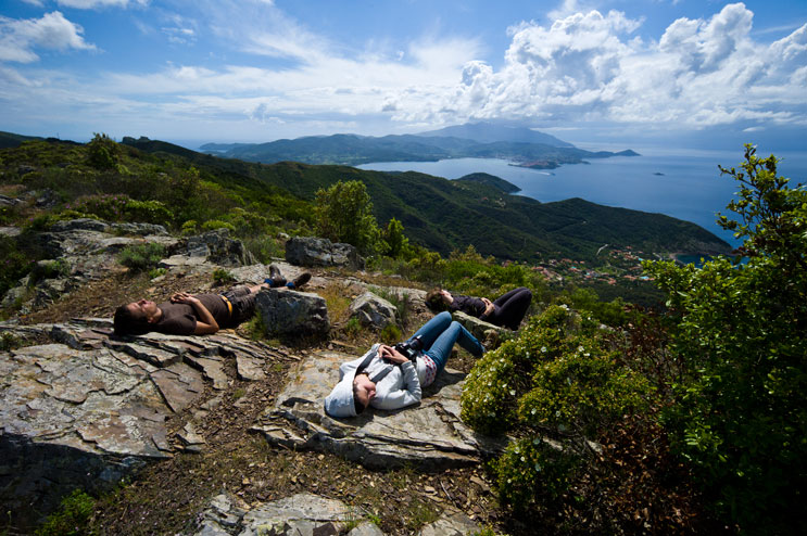 Florian Peljak, Beth Suda and Corinna Vermeersch take a break after hiking up the steep and strenuous trail to Monte Strega, Rio nell'Elba, Monday, May 21, 2012.