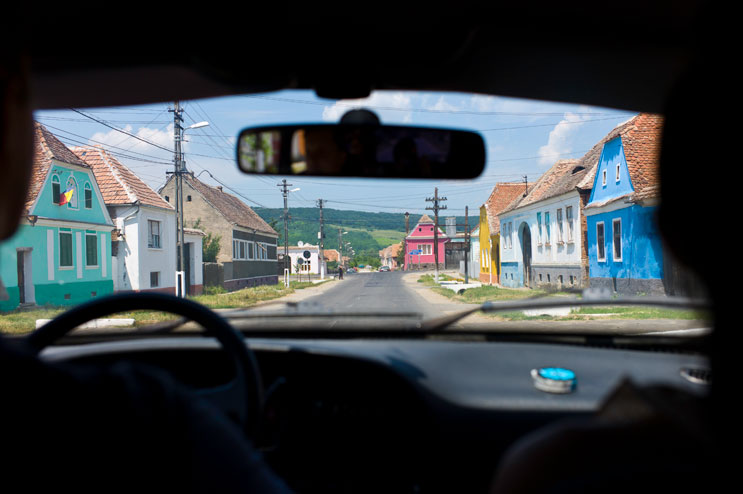 One of the things that really stuck with me is how colorful the houses are in Transylvania. Passing through a typical village on our drive from Medias to Sighisoara with Catalin and Vivian. Tuesday, July 10, 2012.