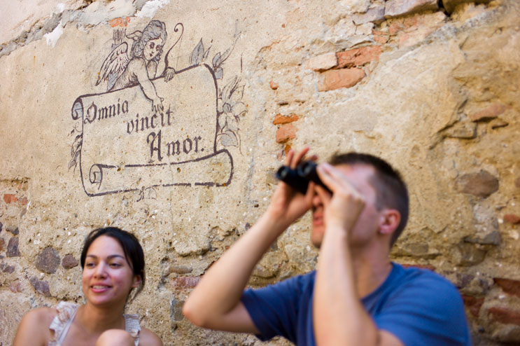 "Catalin and Vivian at the pizza place in Sighisoara. The latin mural behind them translates to ""Love conquers everything."" 'nuff said... Tuesday, July 10, 2012."